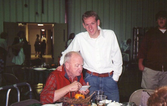 "Jonathan as a young adult taking care of his grandfather.   This was after Dad's stroke and was taken around 2005 at the annual ""Old Fashion Day"" service at our church."
