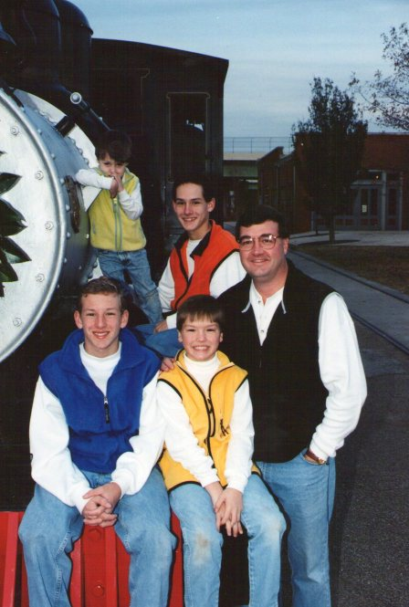 Me and my boys at the depot in downtown Huntsville.   Taken about 1998.