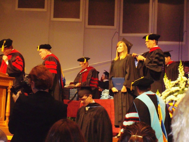 Ashley receiving her college degree.