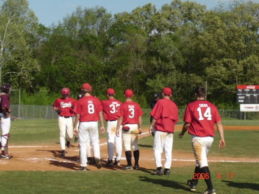 My son, Jon, after hitting his first and only home run in college about to get mobbed at home plate by his teammates.