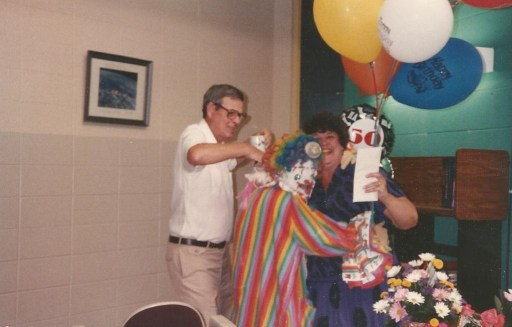 Mom at Butler High School celebrating her 50th birthday. Dad had the clown to come up with the balloons and that is one of her favorite teacher friends, T.J. Lewter.