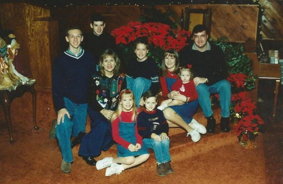 Our Christmas picture from 2002.   Taken on the steps of our altar at church.