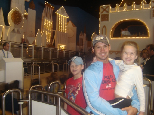 "Jeremiah with Jake and Aubrey at the ""It's a Small World"" ride at Disney World."